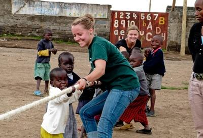 Skilled volunteer on break with students at Special Education project placement in Ghana
