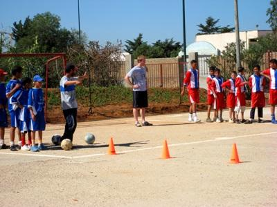 Moroccan children participate in soccer drills at a practice coached by a Projects Abroad volunteer.