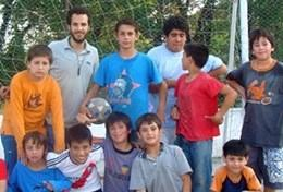 An After School Sports volunteer with his students after finishing a training session in Argentina.