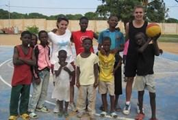 A group of children with their volunteer coach after school in Ghana.