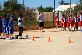 Children practice soccer drills after school with the volunteer sports coach in Morocco.