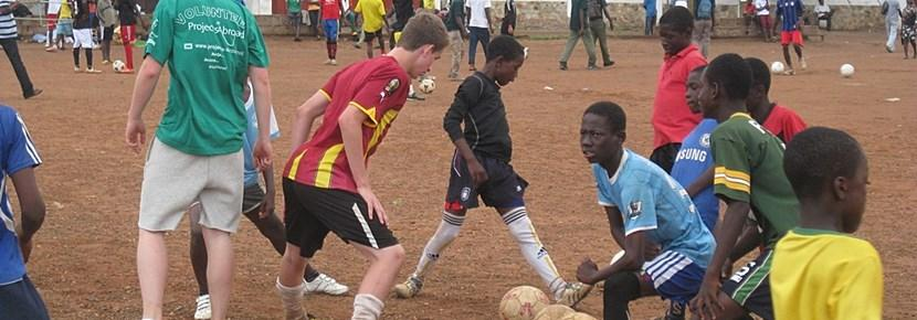 Volunteers coach sports during after-school programs while travelling with Projects Abroad.
