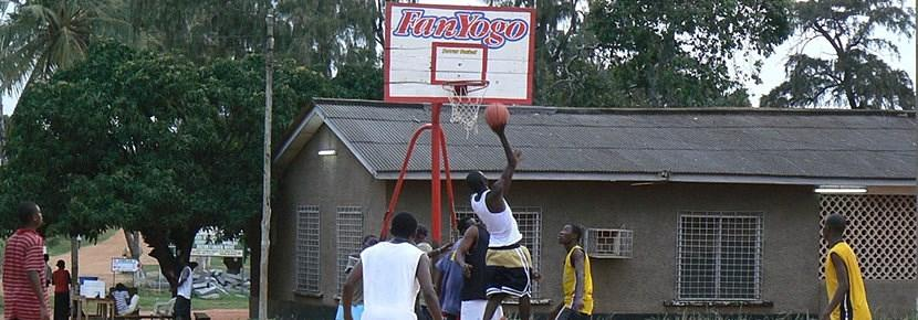 A Projects Abroad volunteer runs a basketball training session in a developing country abroad.