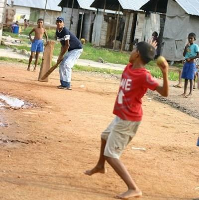Volunteer coaches school children on a Sports project