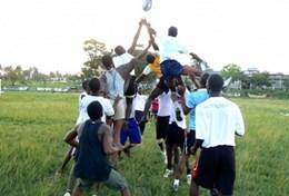 A volunteer coaches a local rugby team in Ghana.