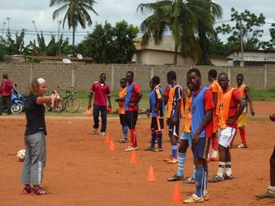Volunteer soccer coach leads an after school club in Togo