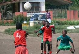 A local team plays soccer during a practice led by a volunteer in Ghana.