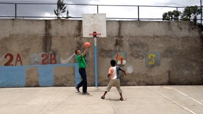 An Ethiopian child plays a game of basketball with a Projects Abroad volunteer