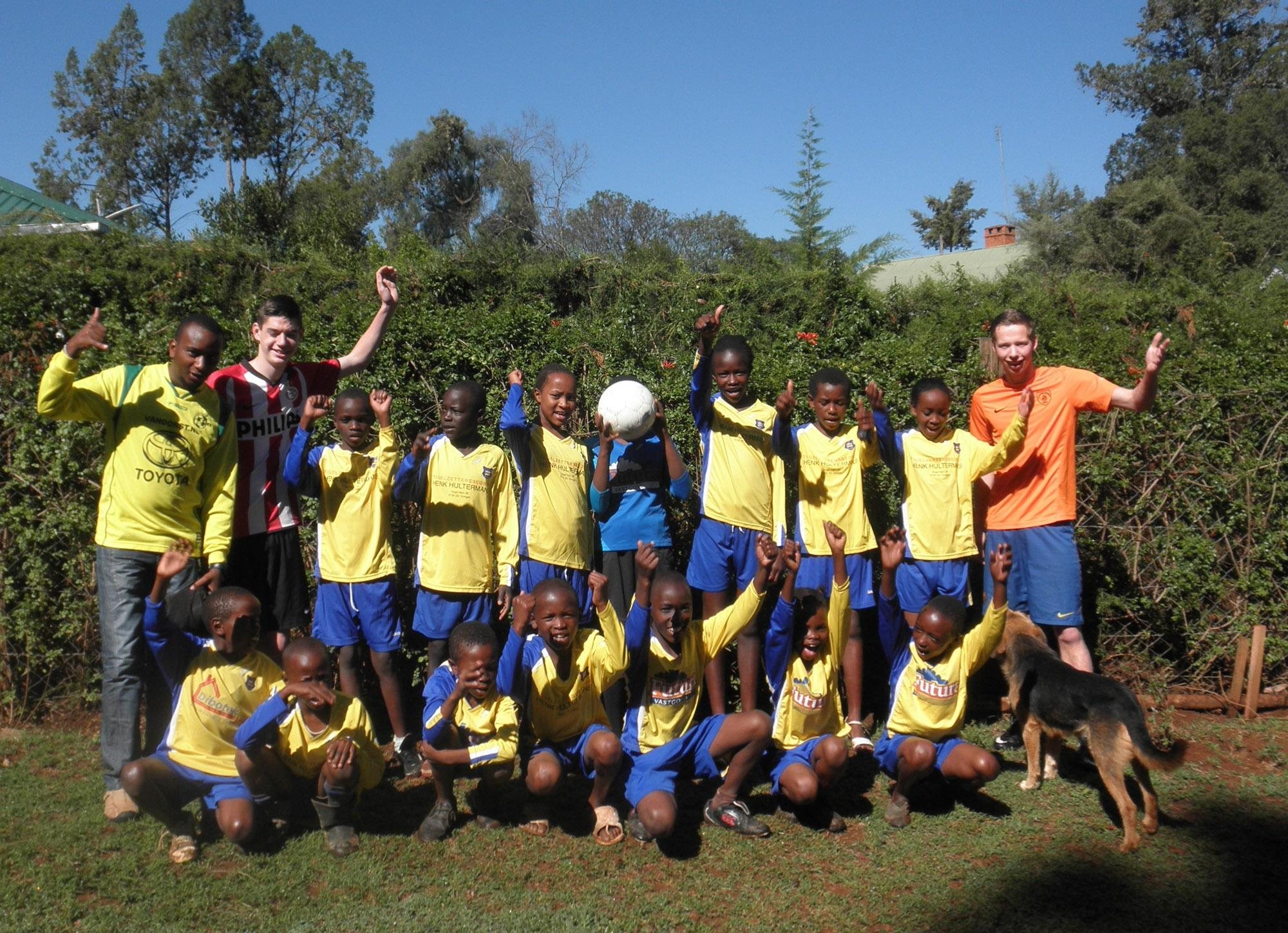 Young members of the school soccer team with Projects Abroad volunteers