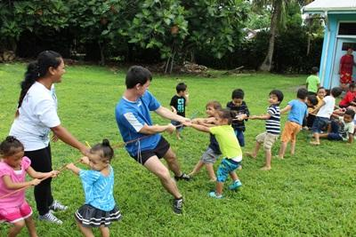 Projects Abroad volunteers in Samoa run games for small children at their placement