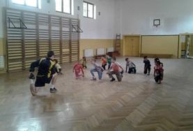 A volunteer does stretching exercises during a physical education class in Romania.
