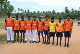 A group of Sri Lankan children pose for a team photo before a physical education class run by a volunteer.