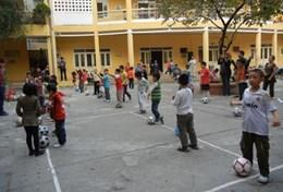 A group of children participate in a physical education class run by a physical education teacher at a school in Vietnam.