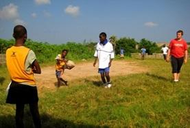 A group of local athletes learn to play rugby with a volunteer abroad.