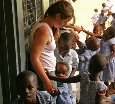 Ghanaian school children get to know their volunteer teacher during playtime.