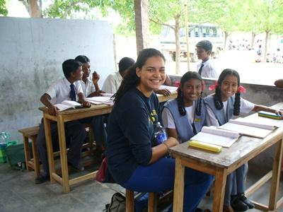 Volunteer on the Teaching project works with students in a school in India