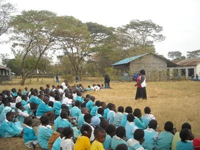 A Teaching volunteer leads a class of elementary school children in Kenya, Africa