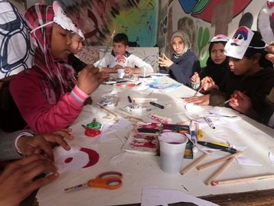 School children in Morocco have fun during a creative exercise planned by a Teaching volunteer.