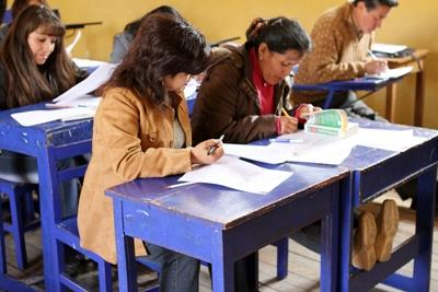 Volunteers assist local teachers by leading them in English lessons in Peru, South America