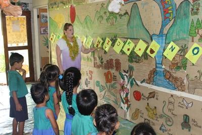 Samoan school children learn the alphabet from a Projects Abroad volunteer teacher.