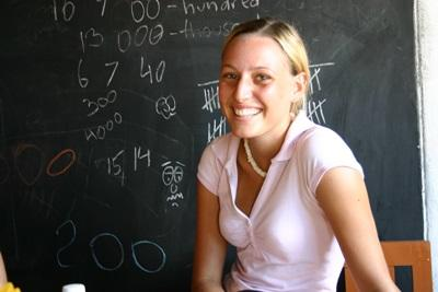 A volunteer poses for a picture in her classroom in Sri Lanka.