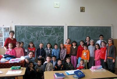Volunteers with their classroom in a school in Romania on the Teaching project