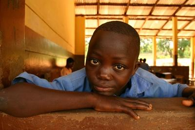 Local boy in a school in Ghana on the Teaching Project