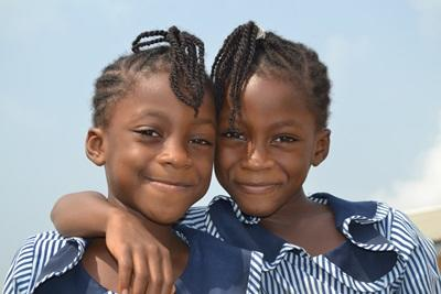 Local girls in Ghana in their school uniforms on the Teaching Project