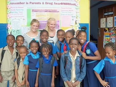 Volunteers with a classroom of students in a school in Jamaica