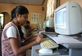 A student practices using Microsoft Word during a class taught by an IT teaching volunteer in Sri Lanka.