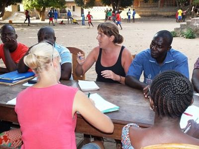 Female volunteer explains a concept to her students in Togo