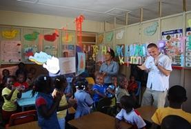 A volunteer leads a French language class at a school in Jamaica.