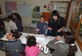 A volunteer teacher helps young students learn and practice basic French in Morocco.