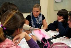 A volunteer teaches German to a group of students in Argentina.