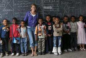 An English teaching volunteer with a group of her youngest students at an Ethiopian school.