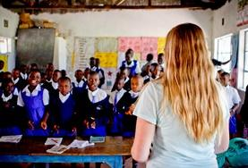 A teaching volunteer in Kenya addresses her class at a local school.
