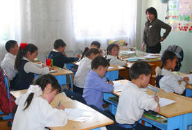 A teaching volunteer leads an English class at a school in Ulaanbaatar, Mongolia.