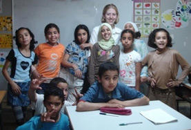 A volunteer teacher with her English Club students at a school in Morocco.