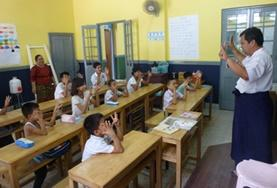 A teaching volunteer and a young student in Myanmar.
