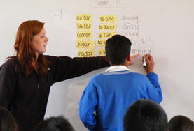 A volunteer teaches English at a high school in Peru.