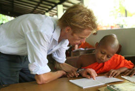 A volunteer teaching English with her students at a school in Sri Lanka.