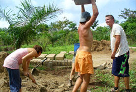 Volunteers work to build a new house in a rural area in the Philippines, Asia.