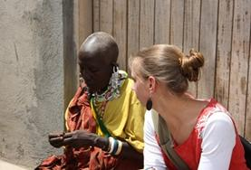 A volunteer on the Culture & Community Project speaks with a local woman in Asia.