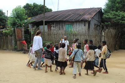 Madagascan children play with a Projects Abroad volunteer in the small town of Andasibe, Madagascar.