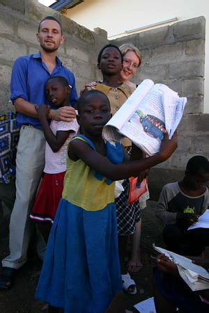 Projects Abroad volunteers help children improve their reading ability in a developing country.