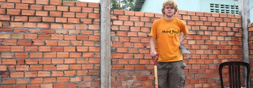 A Projects Abroad volunteer helps dig a foundation at his Building Project in a developing country.